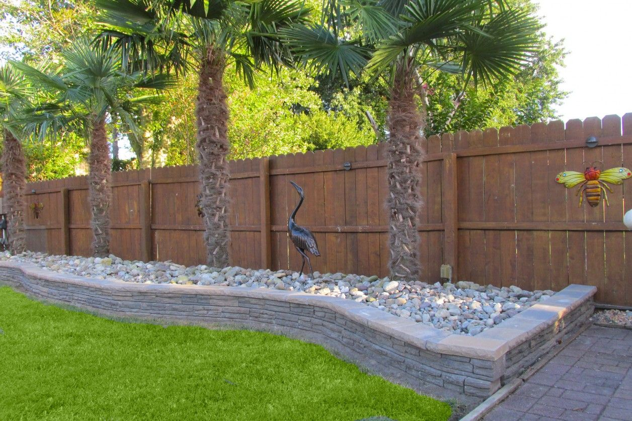 Best driveway landscaping ideas with fence landscape for Landscape retaining wall design