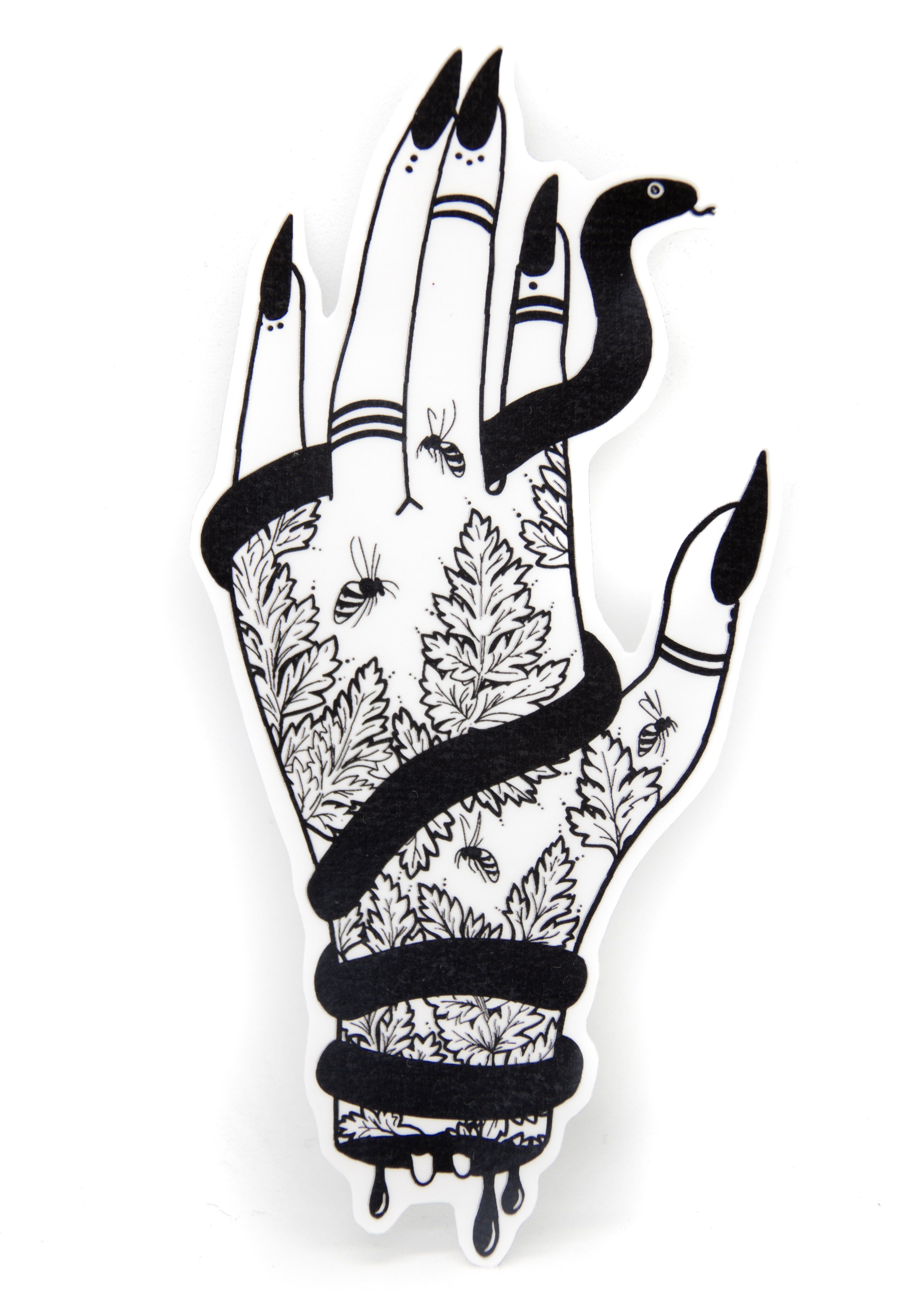 Black and white sticker of a witchy tattooed hand holding