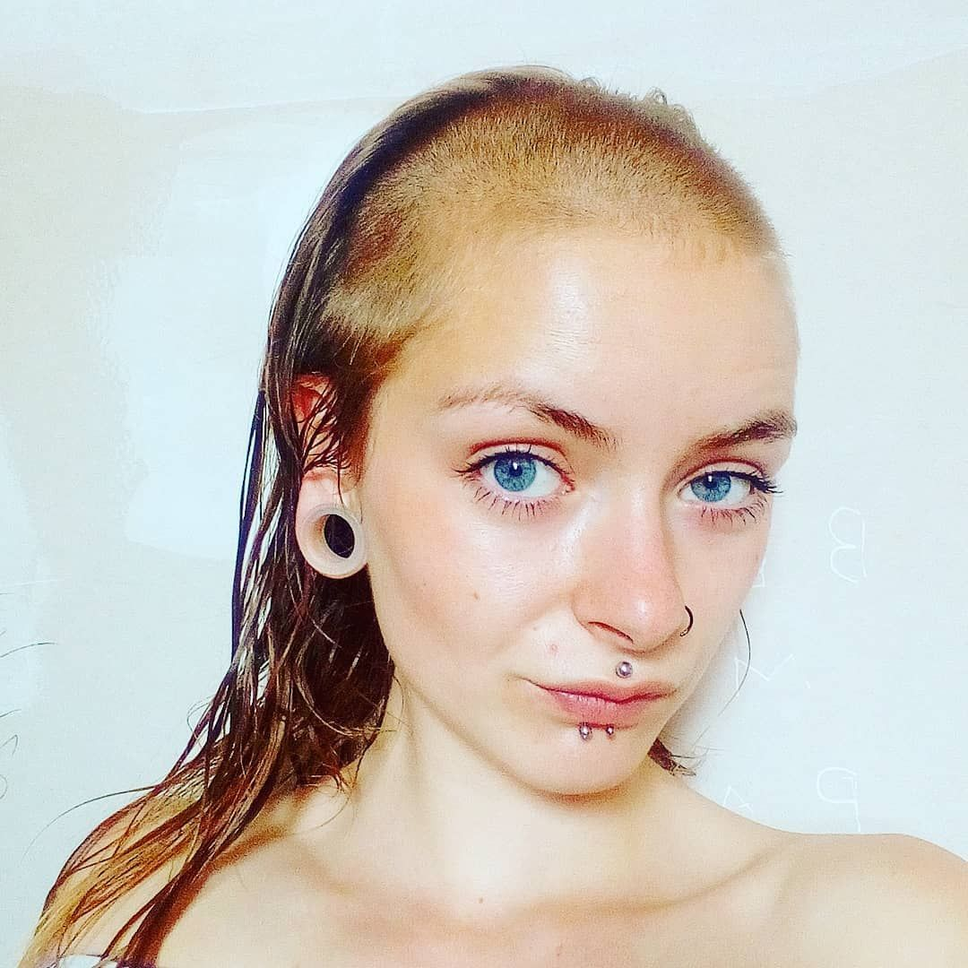 young woman with skullet hair cut / shaved bangs / buzzed bangs