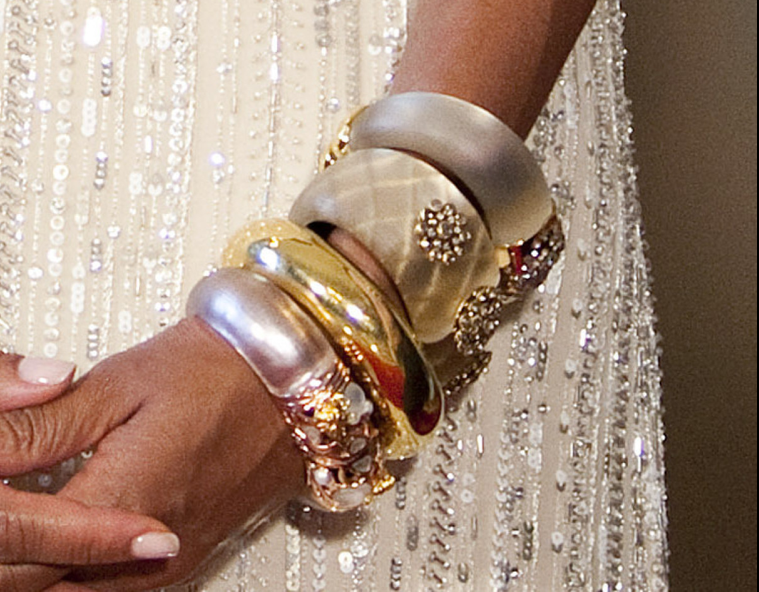Beauty Board: Michelle Obama in Naeem Khan and Alexis Bittar lucite bracelets.