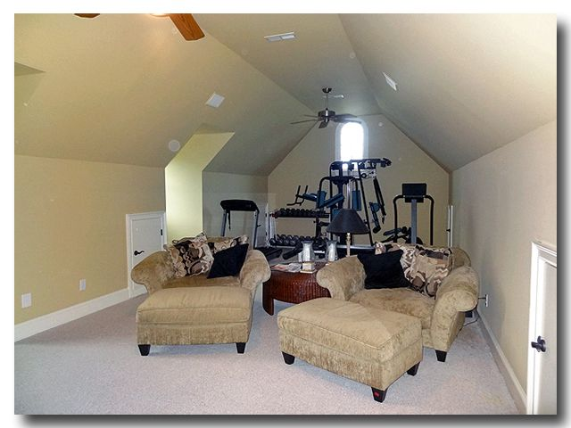 This Bonus Room is large and set-up with exercise equipment and a small media center. It offers many possibilities.