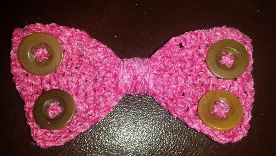 Crocheted Bow. Crocheted in a suede type wool and decorated with button. I Make these and add them onto clip or headbands. £4 on headband £3.50 on clip