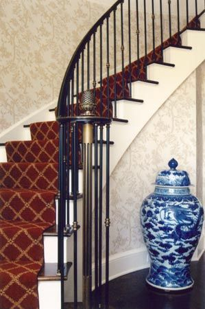 Jozef Custom Ironworks | Iron, Bronze, Curved Stair Railings, Spirals, Gates, Bronze newel post with pineapple finial is the main attraction of this iron railing. Bronze handrail and bronze collars are the additional decoration. Satin finish. New Canaan, CT 2003.