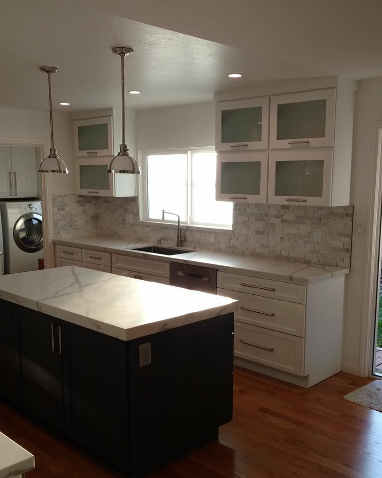 kitchen remodel with white shaker cabinets white back