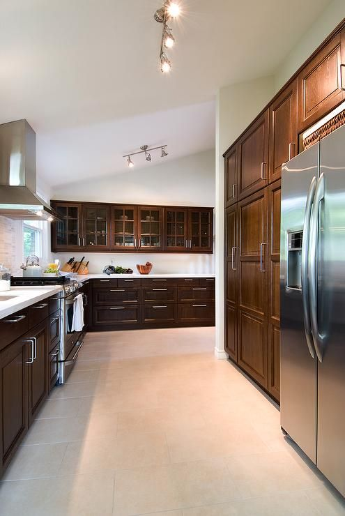 Lejla Eden Interiors - dark cabinets + white counters + white walls (Benjamin Moore Simply White)