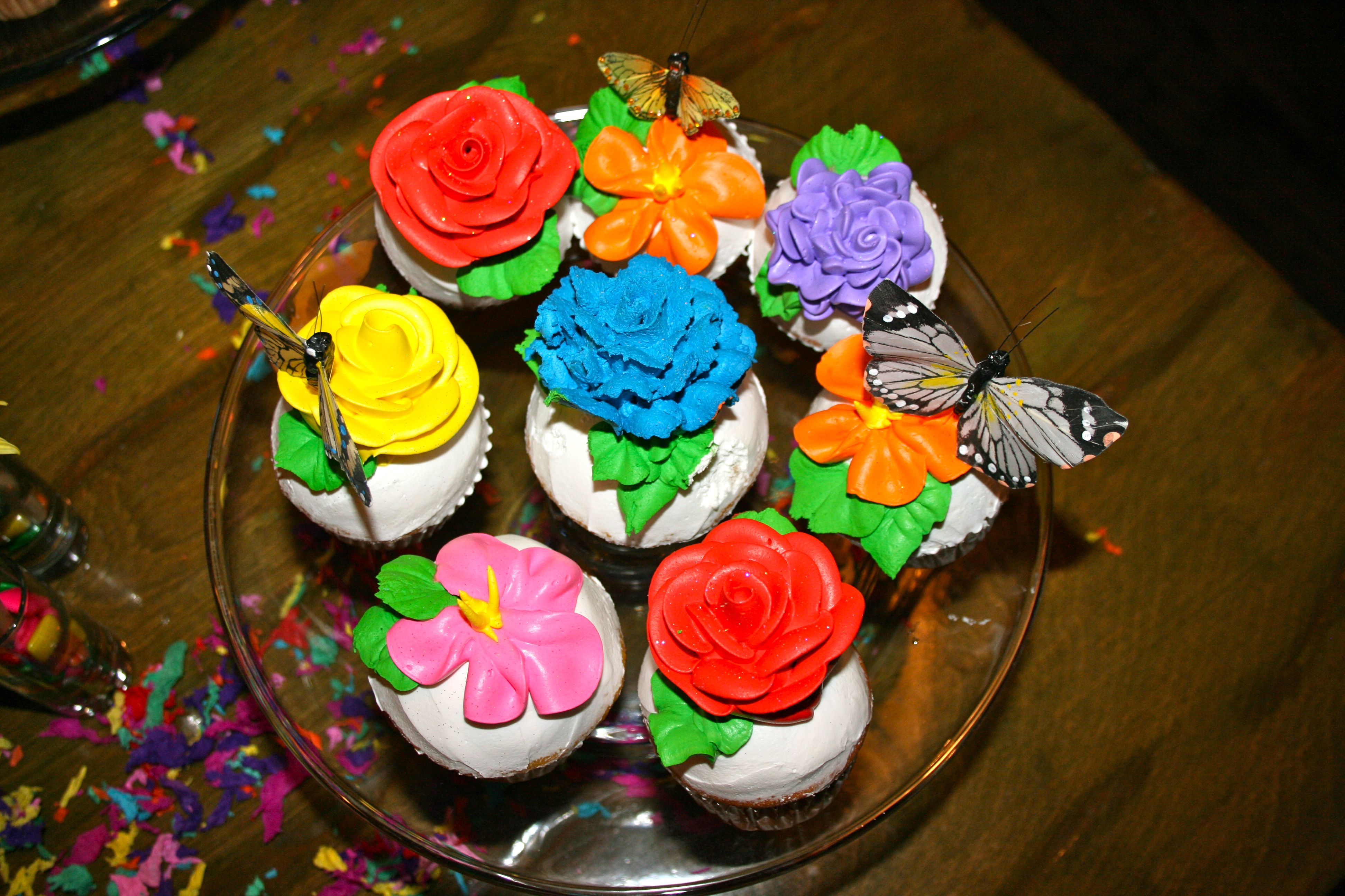 Butterfly cupcake toppers on beautiful flower cupcakes this was butterfly cupcake toppers on beautiful flower cupcakes this was done for a fiesta baby shower izmirmasajfo
