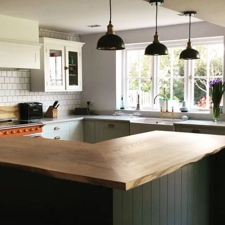 Live edge L shaped kitchen island top 2170x1030mm & 2065x1000mm earthy features enhanced with resin, waterproof finish, embedded in timber supports for 300mm overhang www.earthytimber.com #beautifulkitchen #kitchenisland #largekitchenisland #openspacekitchen #largekitchendesign #woodenisland #islanddesign #liveedgeisland #liveedgebreakfastbar #woodbar #kitchendesignideas #earthy #homerenovation #houserenovation #islandworktop #oakworktops #earthydesign #livingedge #liveedge #lshapeisland