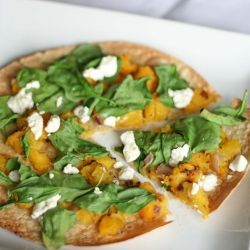 A simple yet delicious pizza with roasted butternut squash, fresh spinach, caramelized onion, and goat cheese.