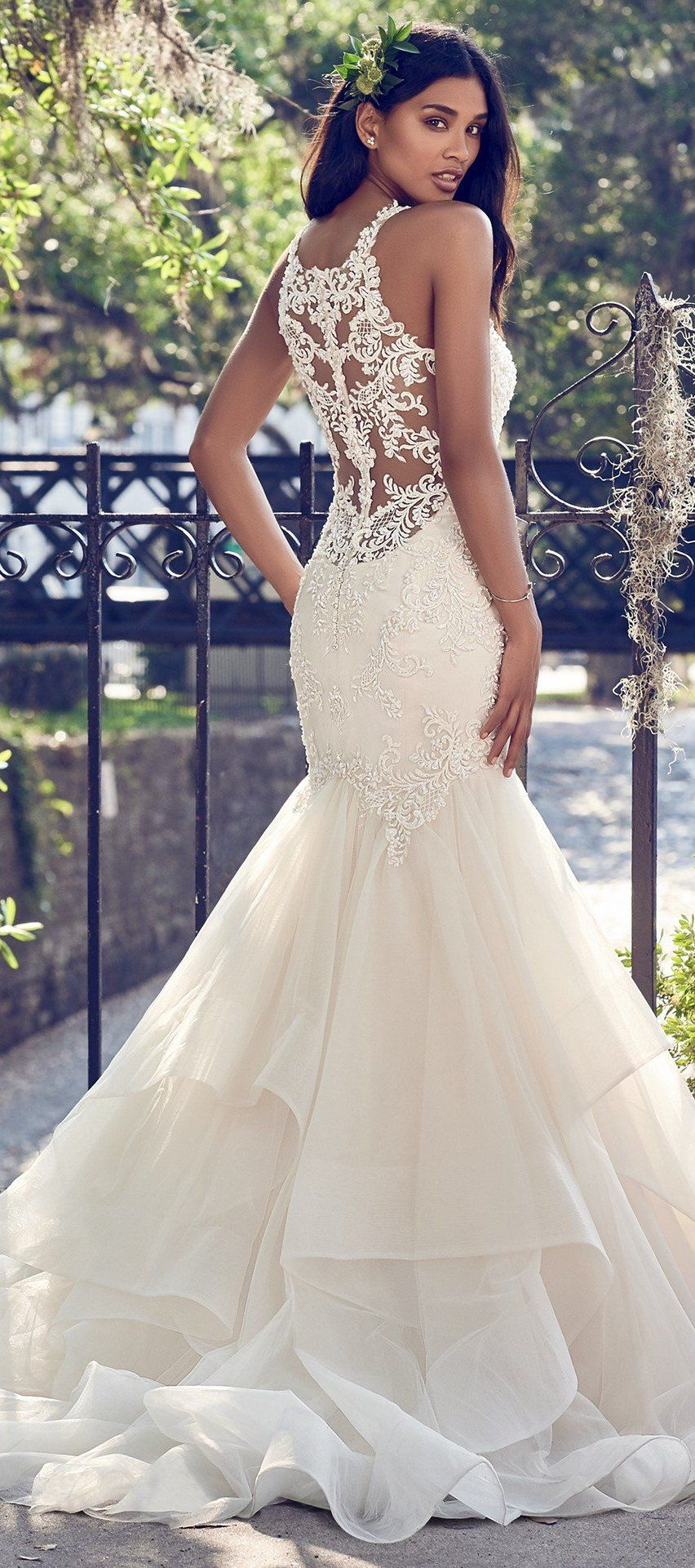 a51d62ddba92 ... Beaded lace motifs and Swarovski crystals adorn the bodice, illusion  back, and halter neckline with illusion plunging V in this wedding dress. A  tiered ...