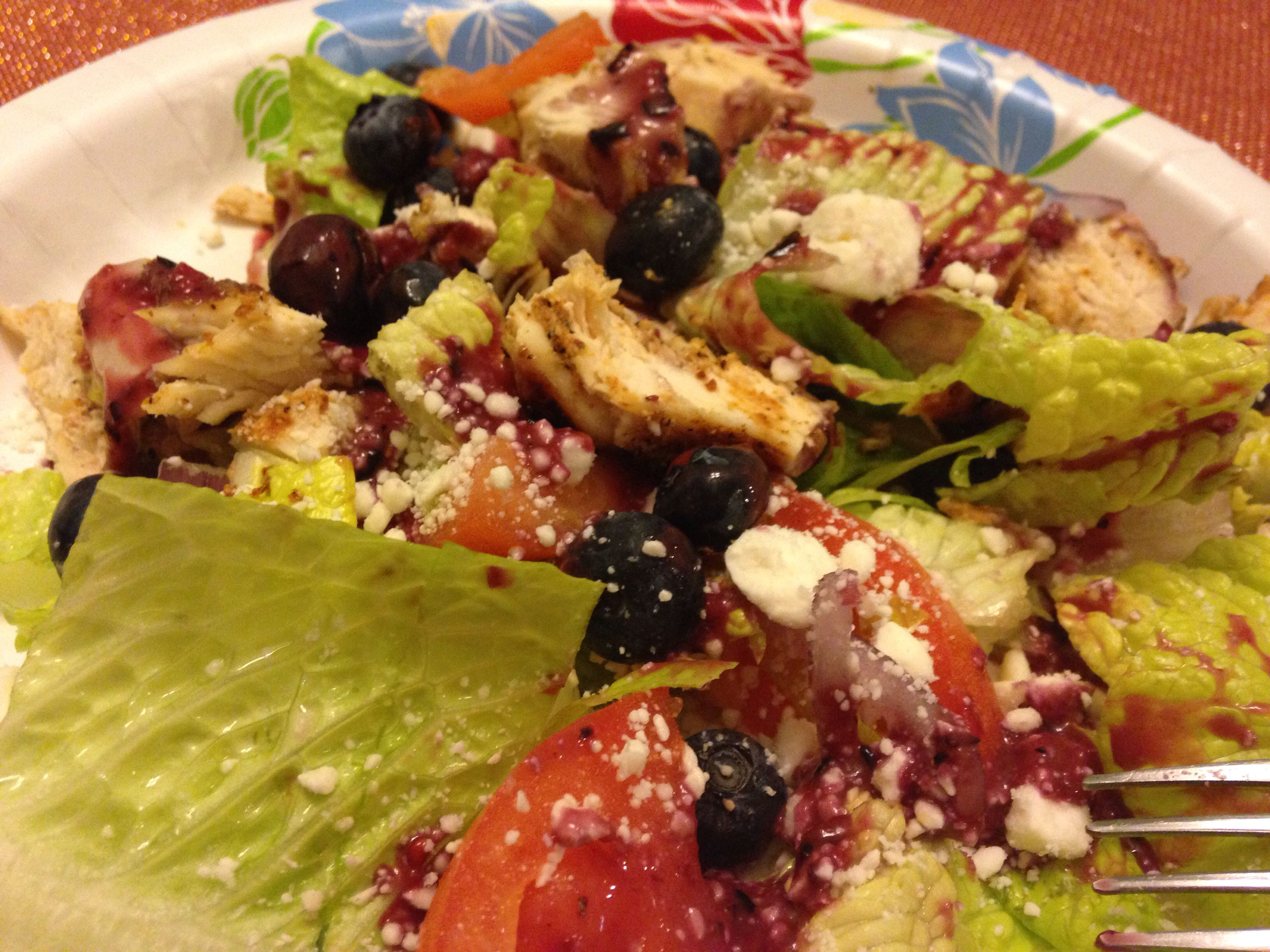 Grilled chicken, blueberry, feta salad with a berry balsamic vinaigrette. 315 calories.