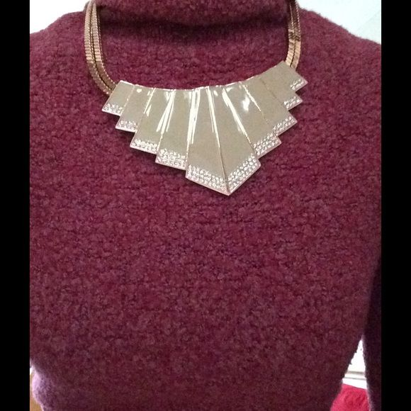 Vince Camuto Fashion Statement Necklace Make a fashion statement with this beautiful jaunty necklace from Vince Camuto. Gold platted, doubled chained, lobster claw lock, with detailed rhinestones. New, never used. Vince Camuto Jewelry Necklaces