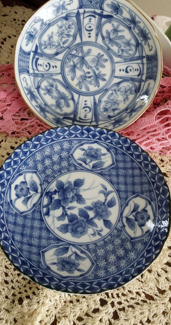 two blue white takahashi san francisco small porcelain plates