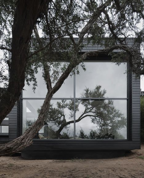 cool flat roof cabin in black. thank you finland! | house exteriors