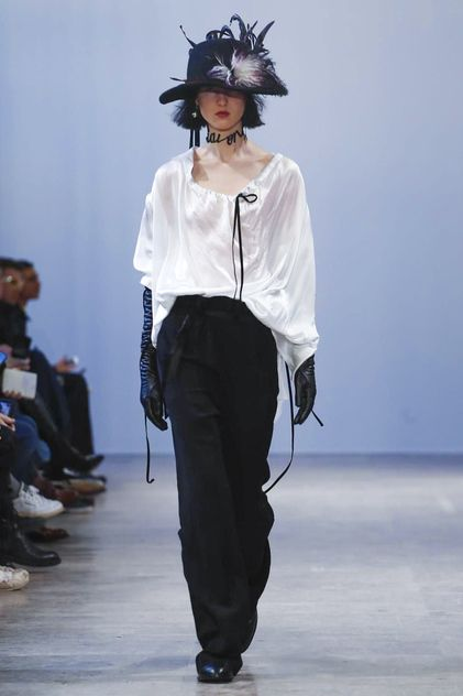 At Ann Demeulemeester it was an ode to Puss in Boots - feather hats, romantic shirting with ribbons trailing, feathered jackets and a bohemian breeze to everything. It was a refreshing collection a...