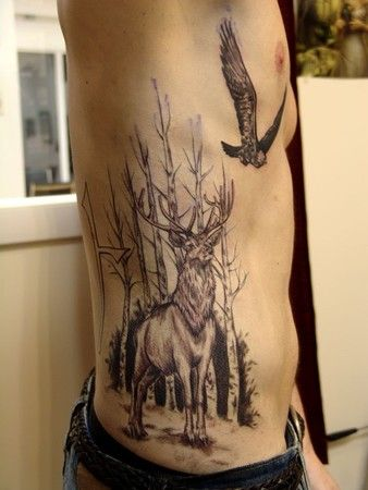 heritage tattoo a white stag among birch trees with a