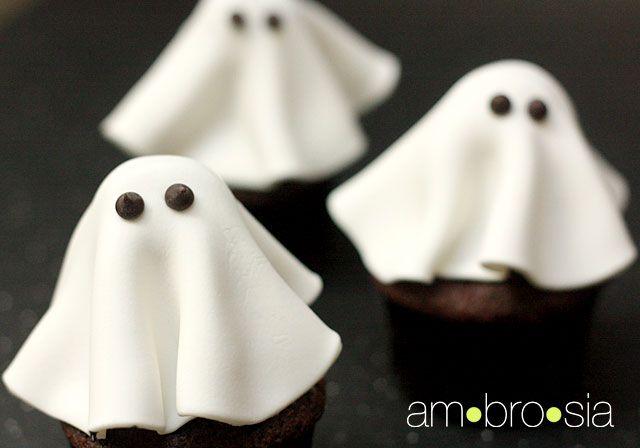 ghost cupcakes tootsie pop stuck inot a cupcake w/ fondant draped