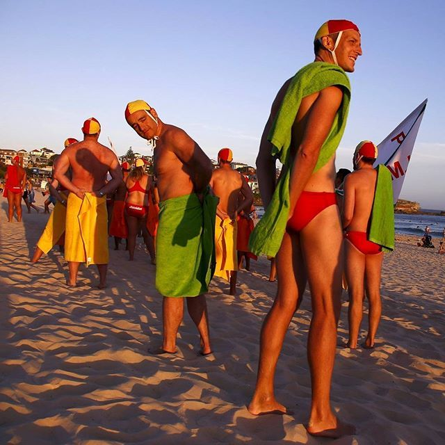 A group of lifeguards rehearse their marching routine on Bondi Beach in  preparation for the upcoming