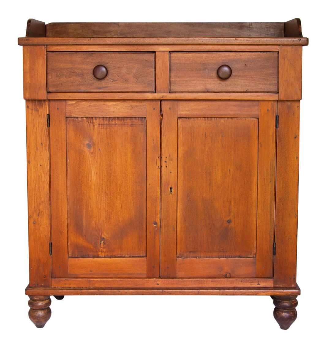 Willis Henry Folk Art & Americana Auction - Day II - Aug. 2, 2015.  Lot 55: 19th C. Two-Door Cupboard.  Realized: $300. Estimate: $300 – $500.  Poplar and pine, dovetailed gallery top, flanking dovetailed drawers with dark walnut pulls, inset panel doors through mortised and pegged, two-shelf interior, original key and lock, all on four turned double bun feet, 47″ h, 41″ w, 17″ d, (ex. Fertig collection).