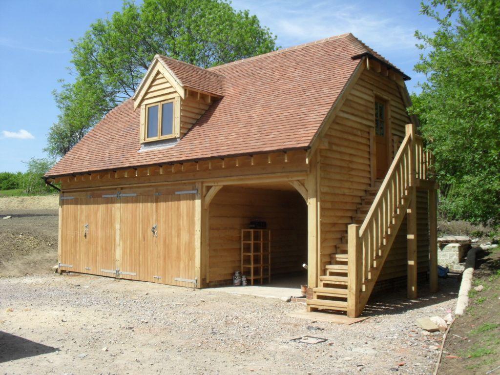Oak Garage with room above and oak staircase | Garage door ...