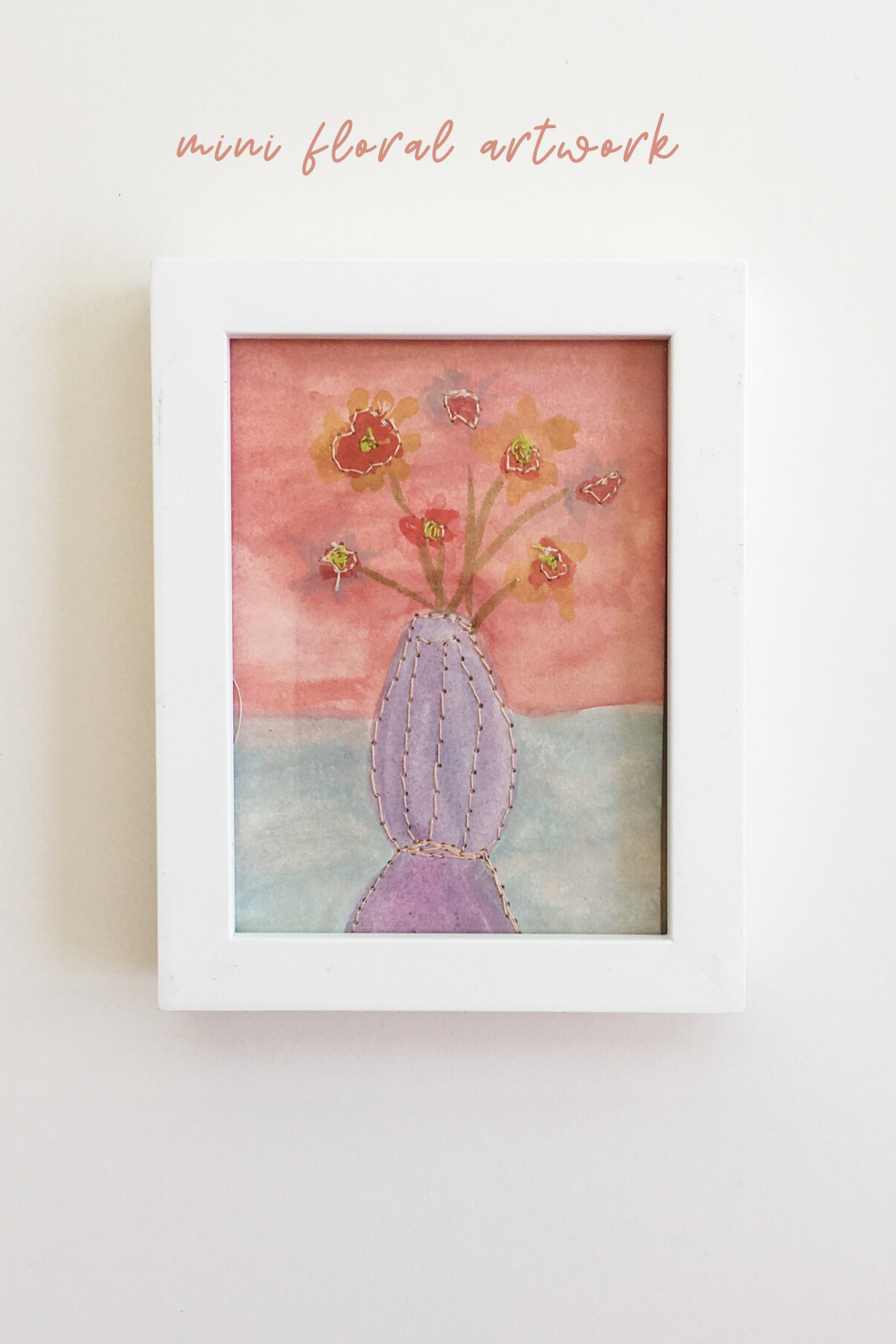 This colorful floral watercolor painting by Meghan Pauley Nespeca would make the perfect Mother's Day gift.  A scene of rosy flowers in a vase is painted on paper and stitched throughout.  #watercolorart #watercolor #art #floralwatercolor #floralwatercolorart #flowerart #mothersdaygifts #artgifts #summerflowers #stitchedpaper #sewnpaper #colorfulhome #smallgifts #flowerlover #gardeninglover #gardengifts #flowergifts #mixedmediaart #mixedmediaartist #artsy #floralhomedecor #colorfulart