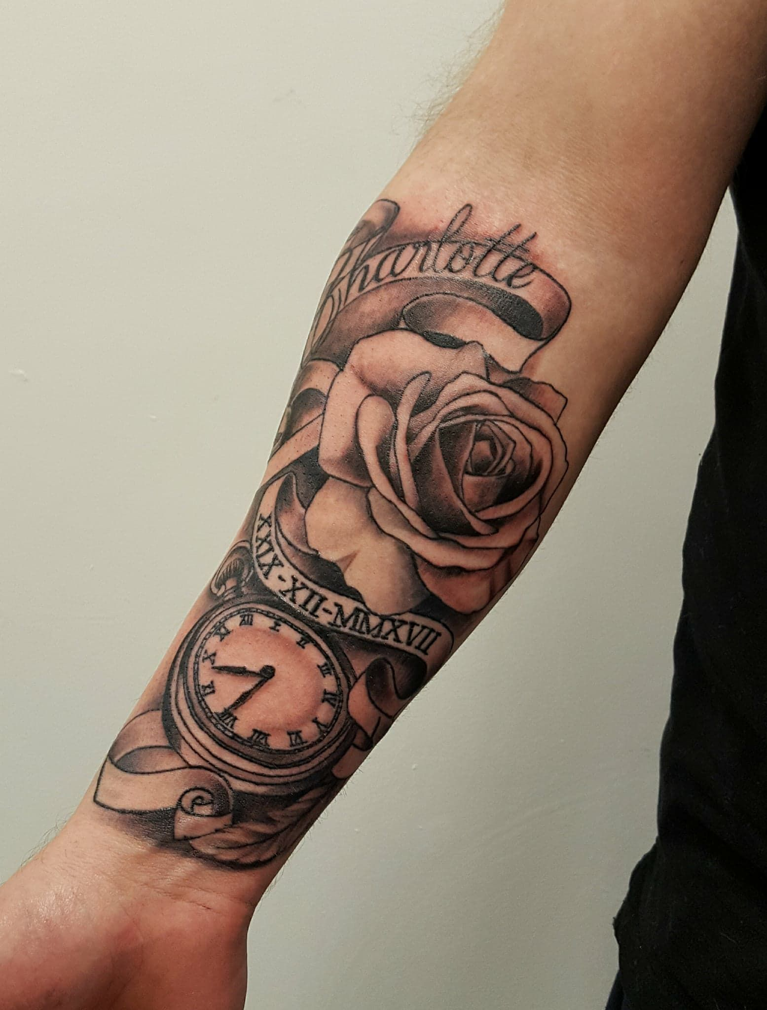 Rose and pocket watch tattoo with name and scroll.