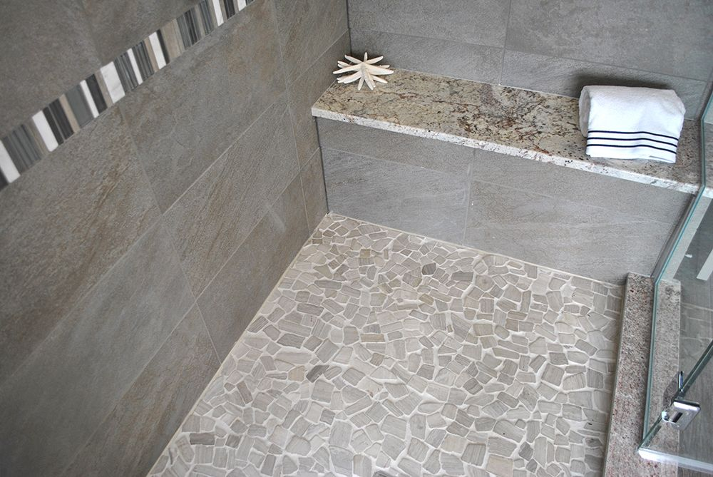 Light Gray Pebble Mosaic Shower Floor With Gray Stone Wall Tile