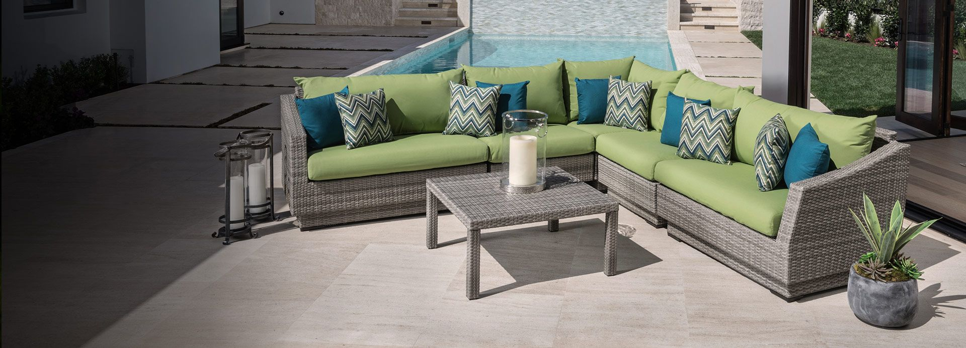 Modern outdoor patio/pool deck furniture. Green and teal cushions ...