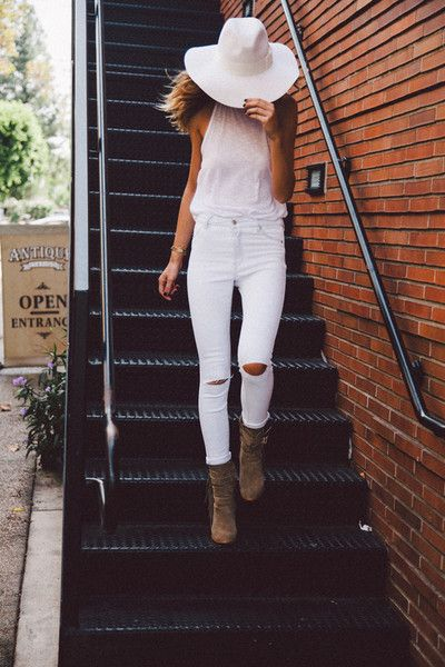 all white everything-fedora, tank, high-rise denim with cutouts. paired with brown booties!