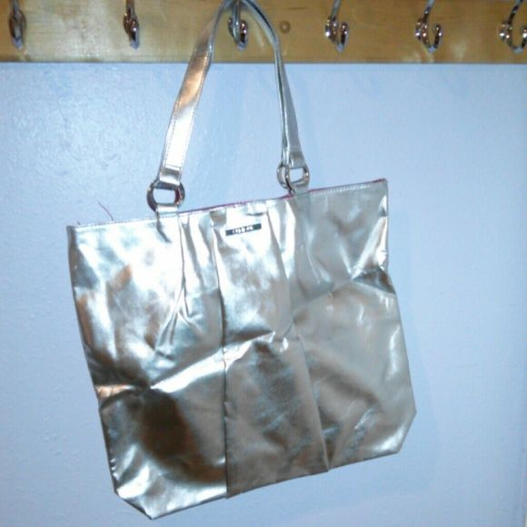 Silver Clinique Bag Clinique bag, never used! Just a bit wrinkled from storage  Measurements: height-14 in, length-15 in, depth-3 1/2 in Clinique Bags