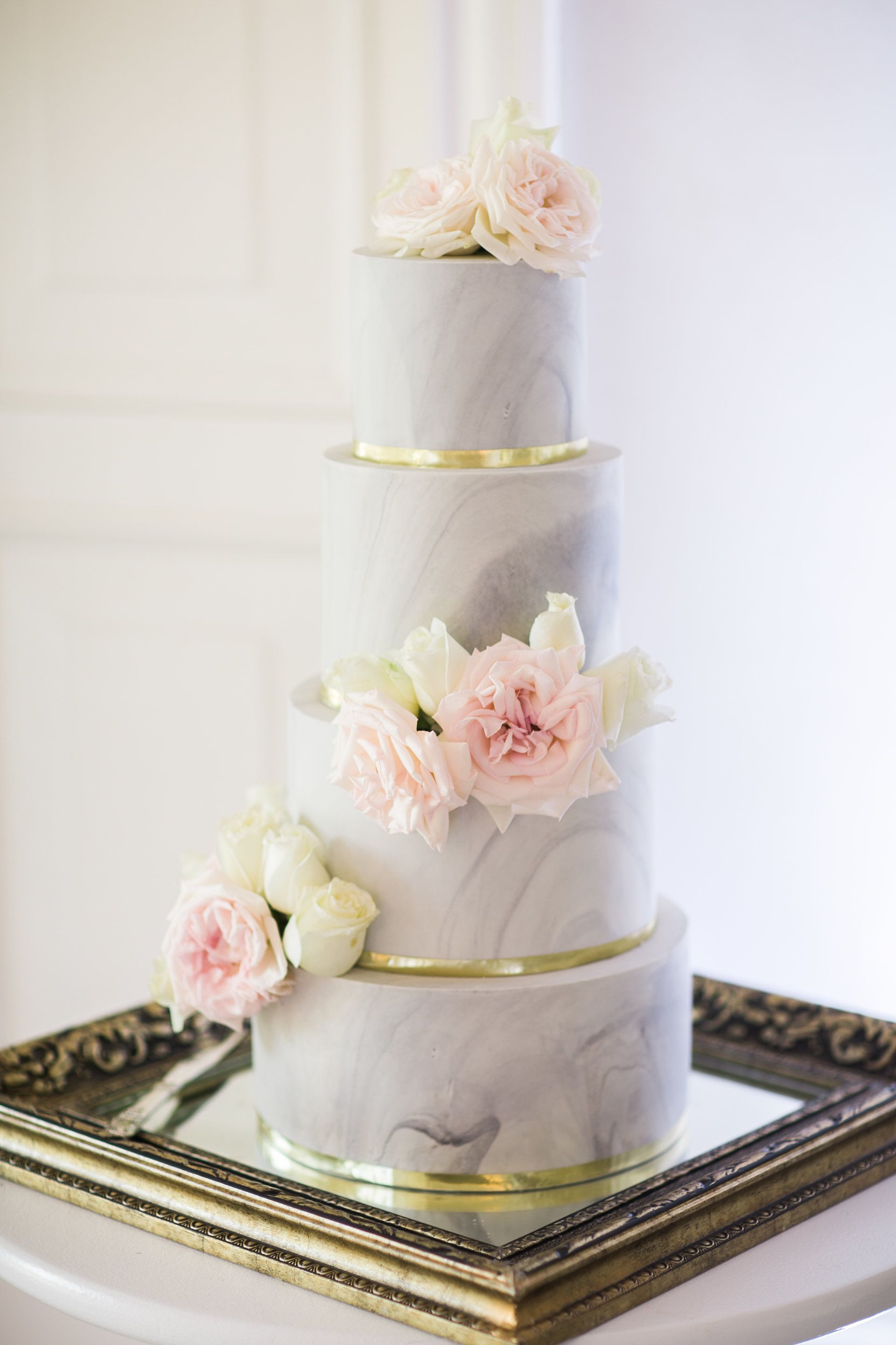 On Trend Four Tier Marble Wedding Cake With Gold Details And