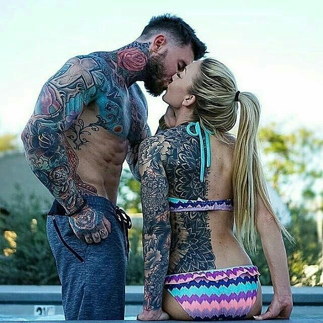 Tattooed students making out
