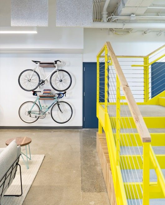 Great idea for a bike display. Shelves hold bike still and create storage above for extra display © Jasper Sanidad