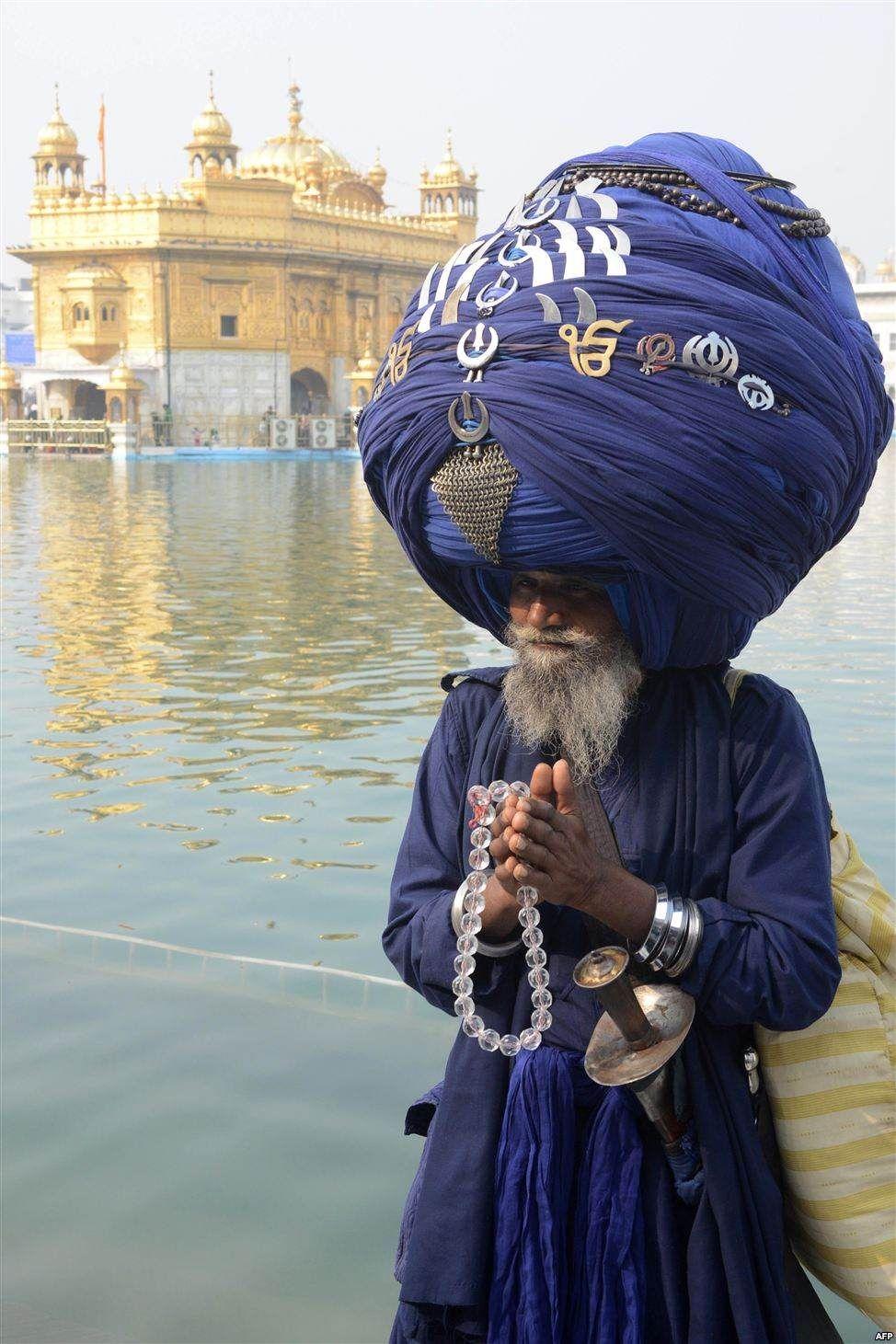 A Sikh displays 300 m turban .