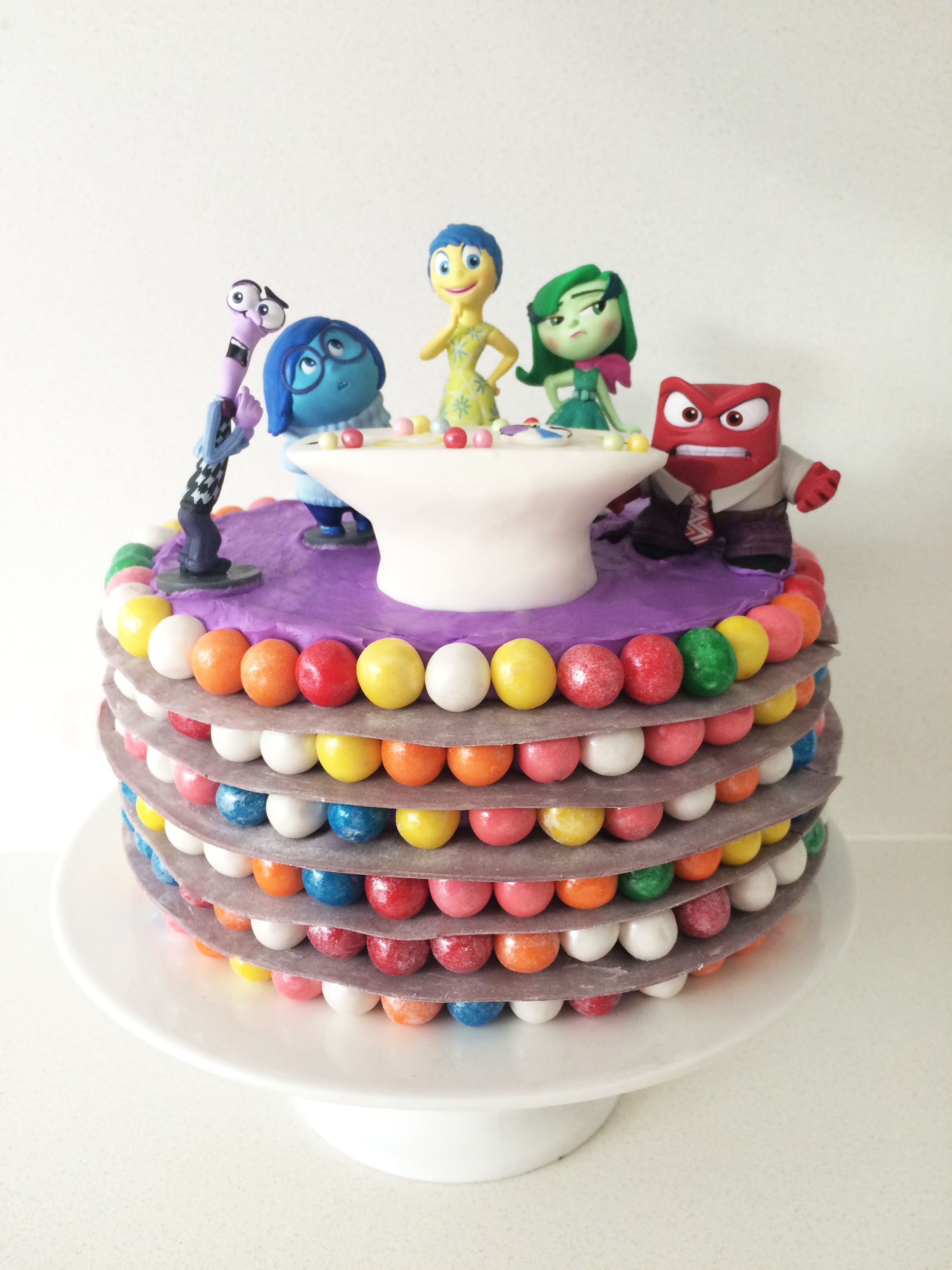 An Inside Out cake inspired by the Disney Pixar movie that is easy