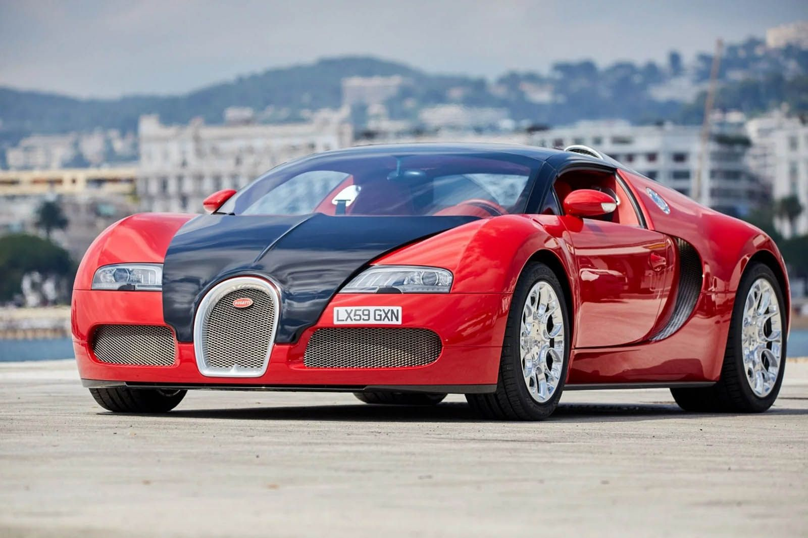 Deep Down This Red Bugatti Veyron Grand Sport Is Actually Blue Carscoops Bugatti Veyron Bugatti Sports Cars Luxury