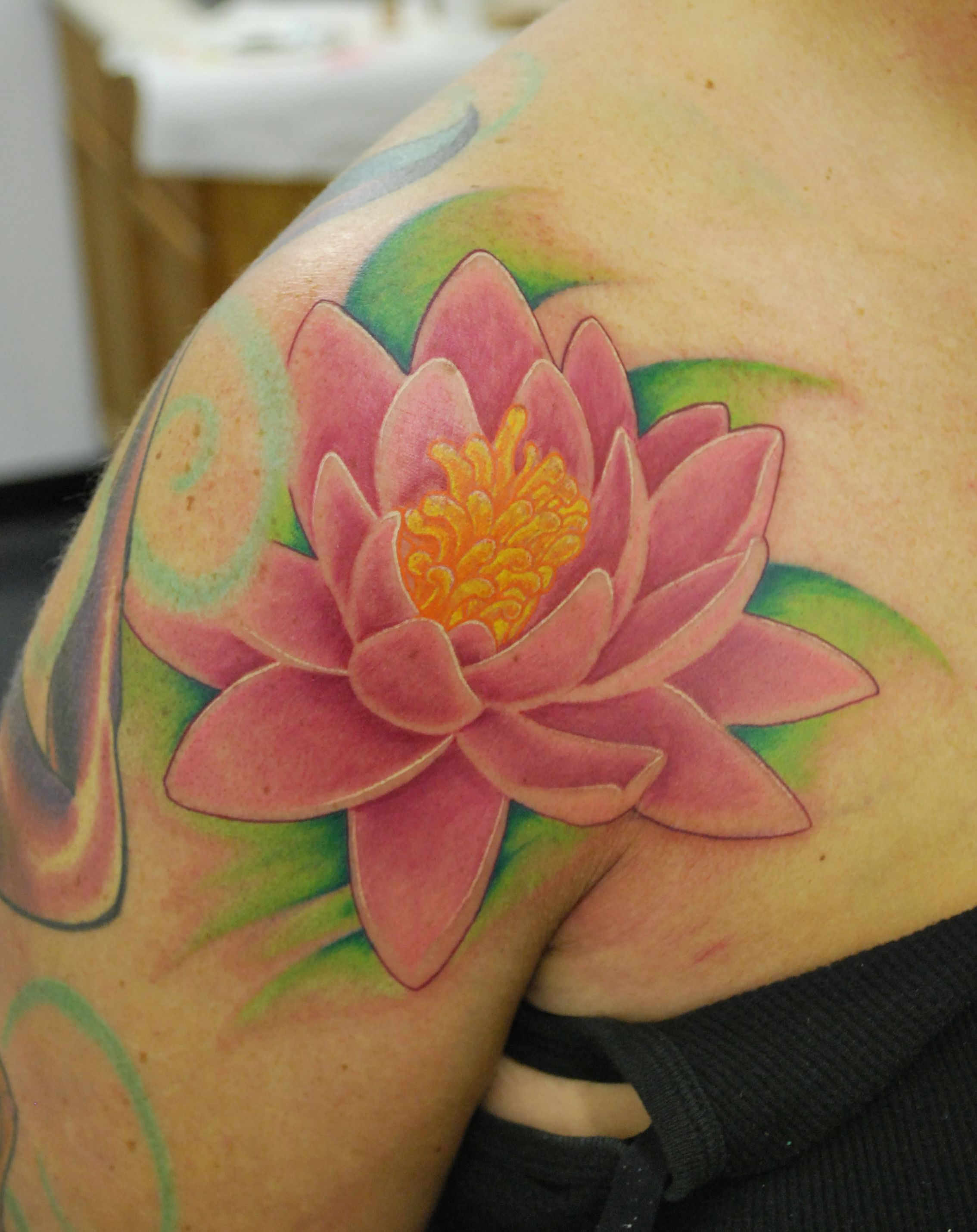 Freehand walk in tattoo water lily on right shoulder by josh 90 lotus flower tattoos i really like the tattoo of just the flower and the outlining thats not in black on the flower nice izmirmasajfo