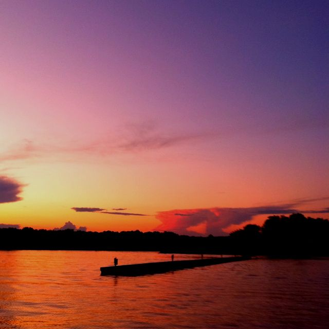 The beautiful sunset on the lake during the summer. I'm ready for summer! <3
