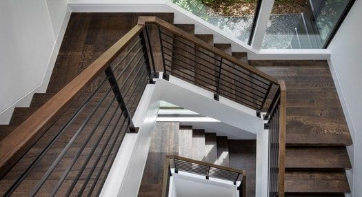 The U Shaped Open Staircase Spans Three Levels.