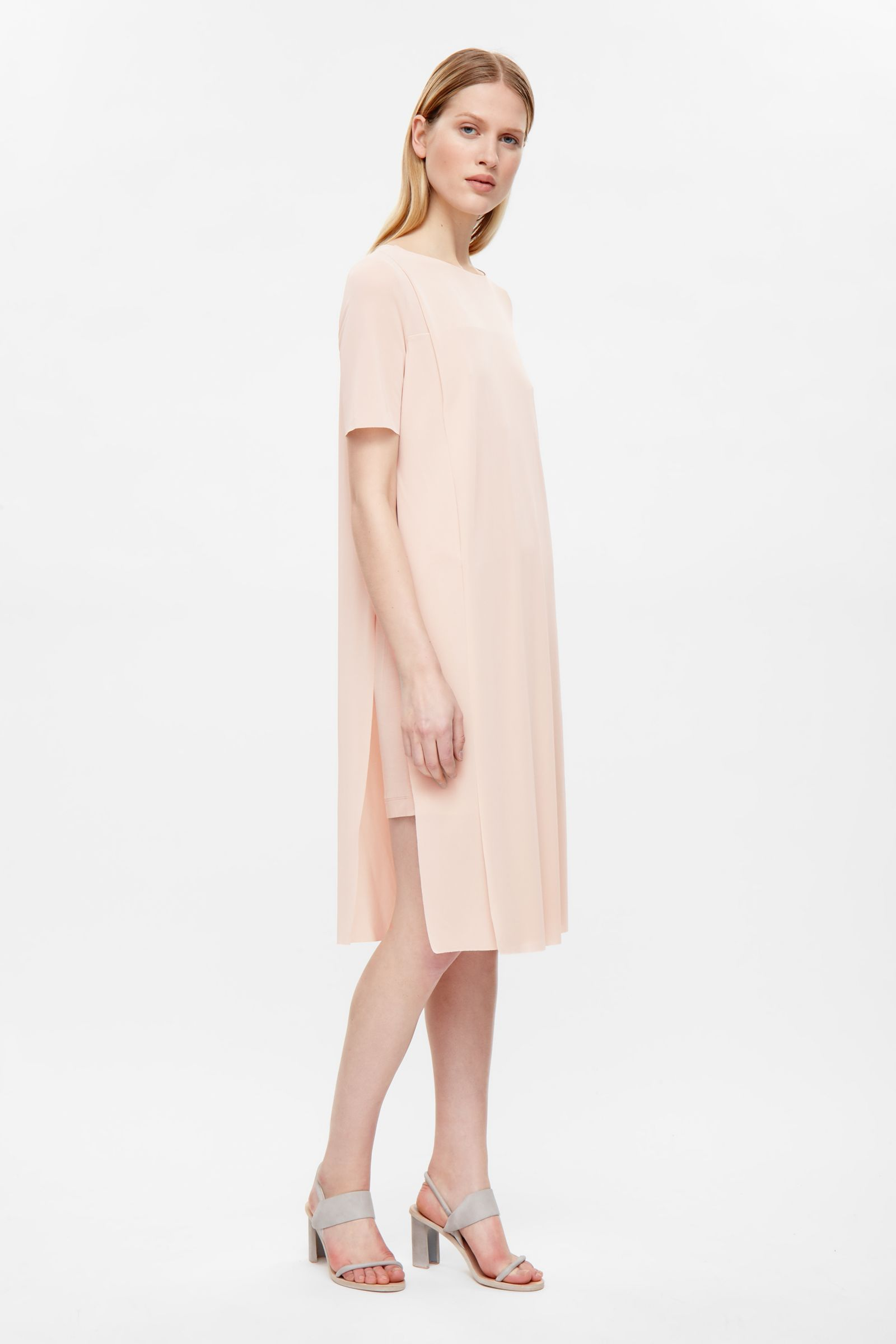 Made from layers of sheer material this long dress has modern raw