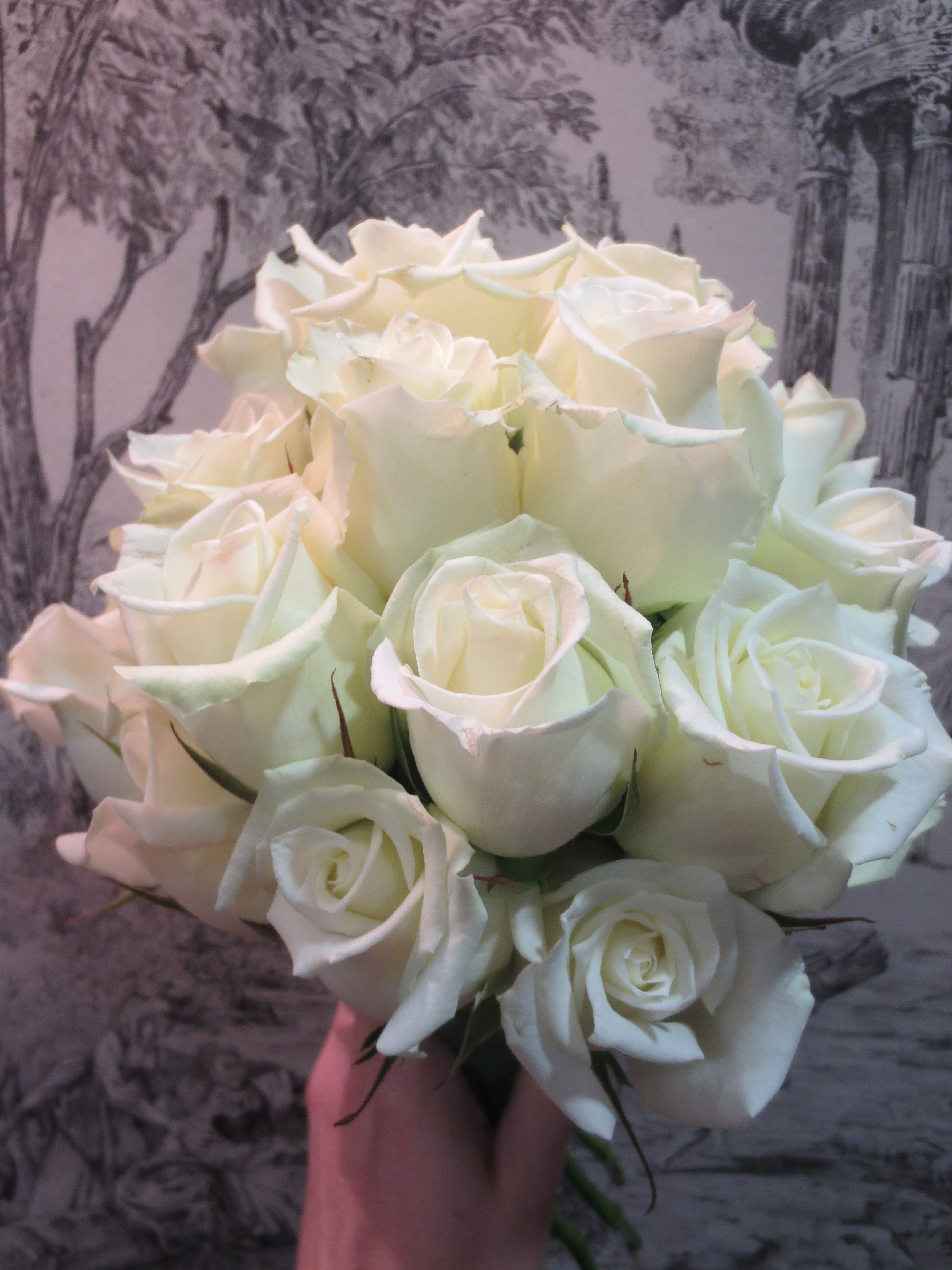Domed white rose bridesmaid bouquet wedding flowers