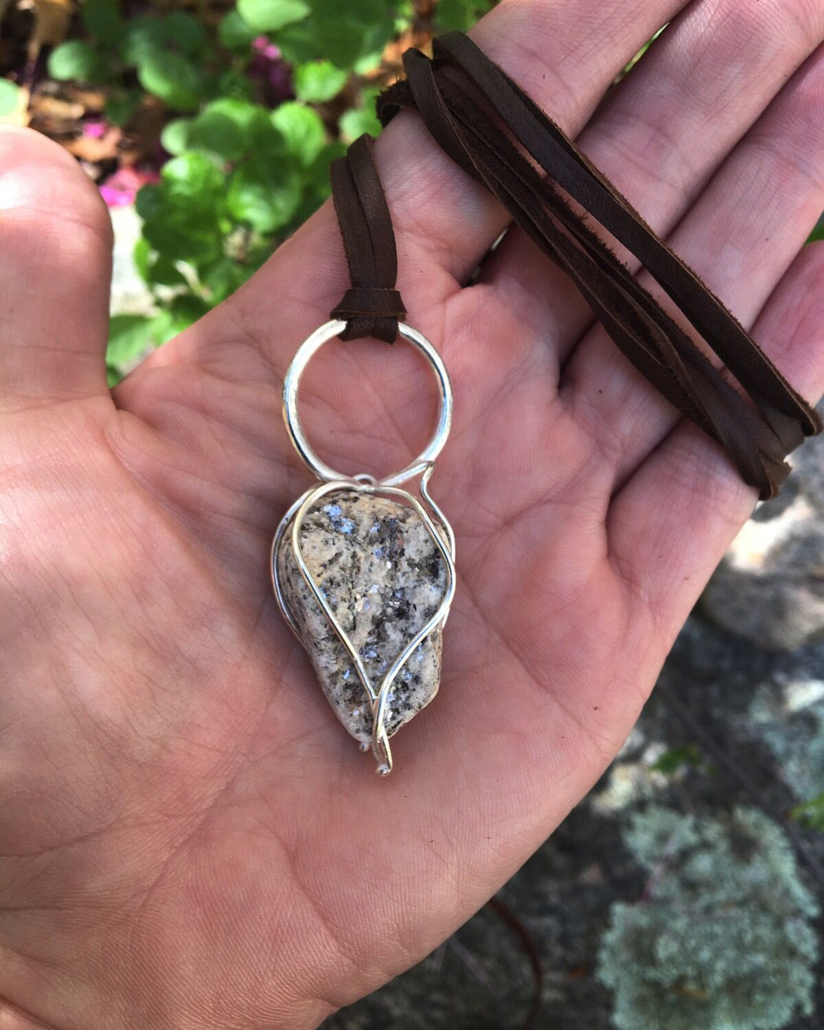 Beach stone in a Sterling cage pendant by New Territory Jewelry