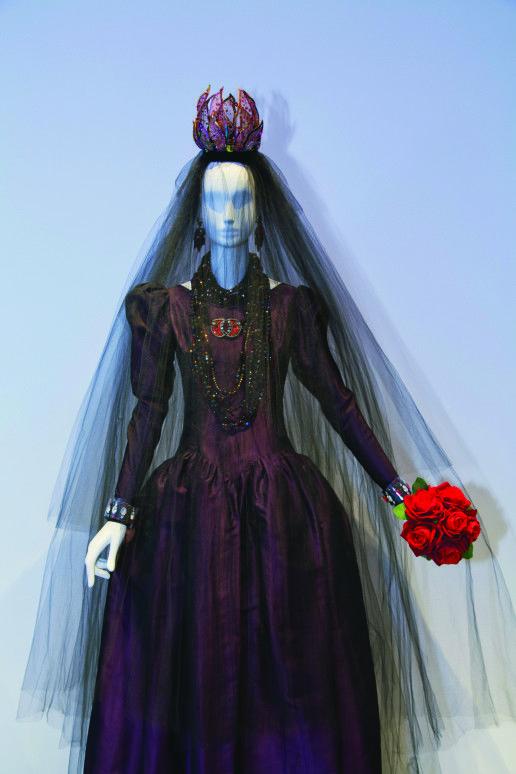 Yves Saint Laurent wedding dress, 1981. Eggplant silk faille, burgundy silk tulle veil, burgundy crown embroidered with beads and sequins. ©...