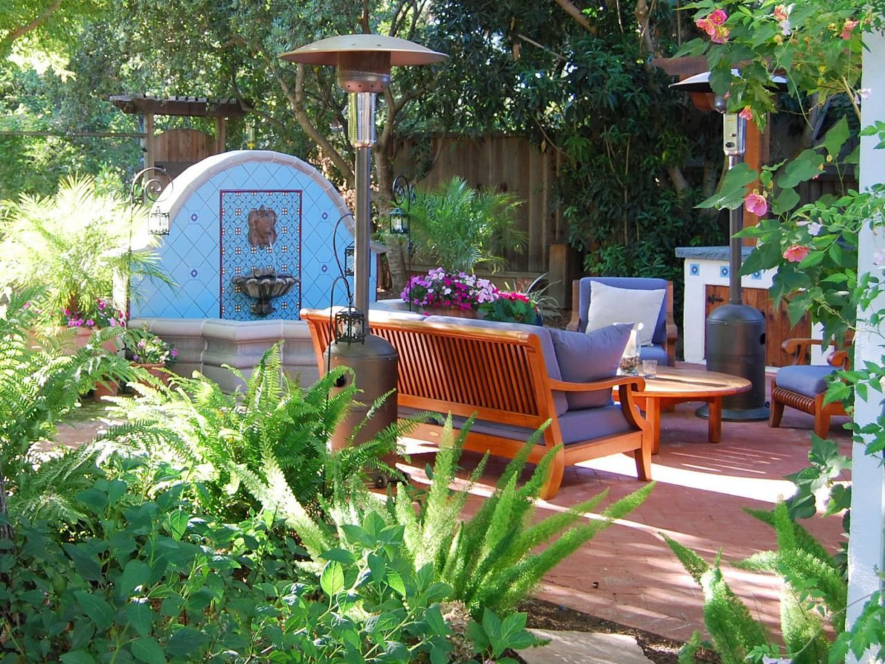 Mediterranean Style Outdoor Sitting Area With Blue Tile Fountain Outdoor Sitting Area