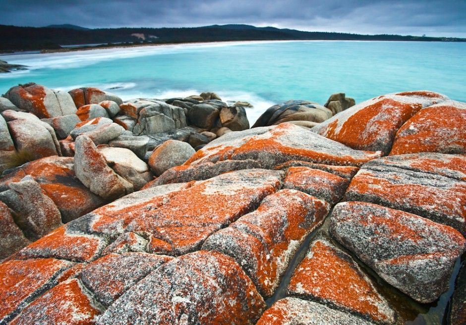 Bay of Fires  The Bay of Fires gets its name from a French explorer who saw fires on the beaches lit by the Aborigines back in the 1700s when it was first discovered by Westerners. But the name can easily be confused with the color of its rocks, which have an orangish glow around them and really make a surreal scene against the backdrop of these beautiful white sand beaches.    Since Lonely Planet named it one of the world's best beaches, foot traffic has slightly increased, but let's be…
