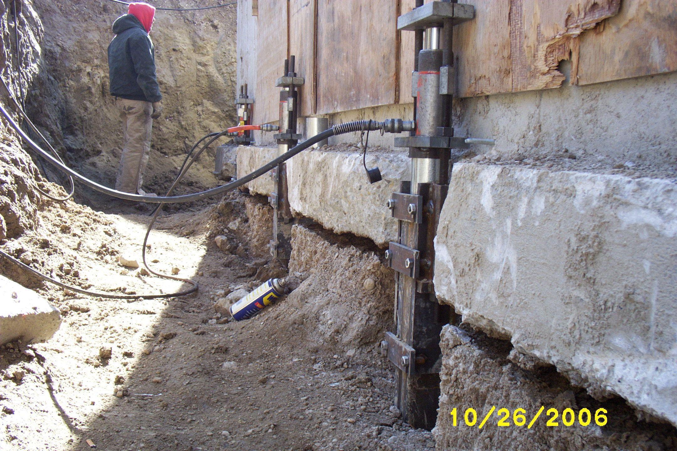 Foundation repair helical piers steel push piers ECP