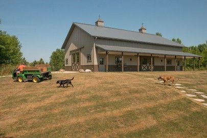 This hobby garage was built for John of Mequon, WI  Special Features:    Morton's Hi-Rib Steel  Cupolas  Porch  Wainscot  Diamon 'M' Sliding Doors  Mo...