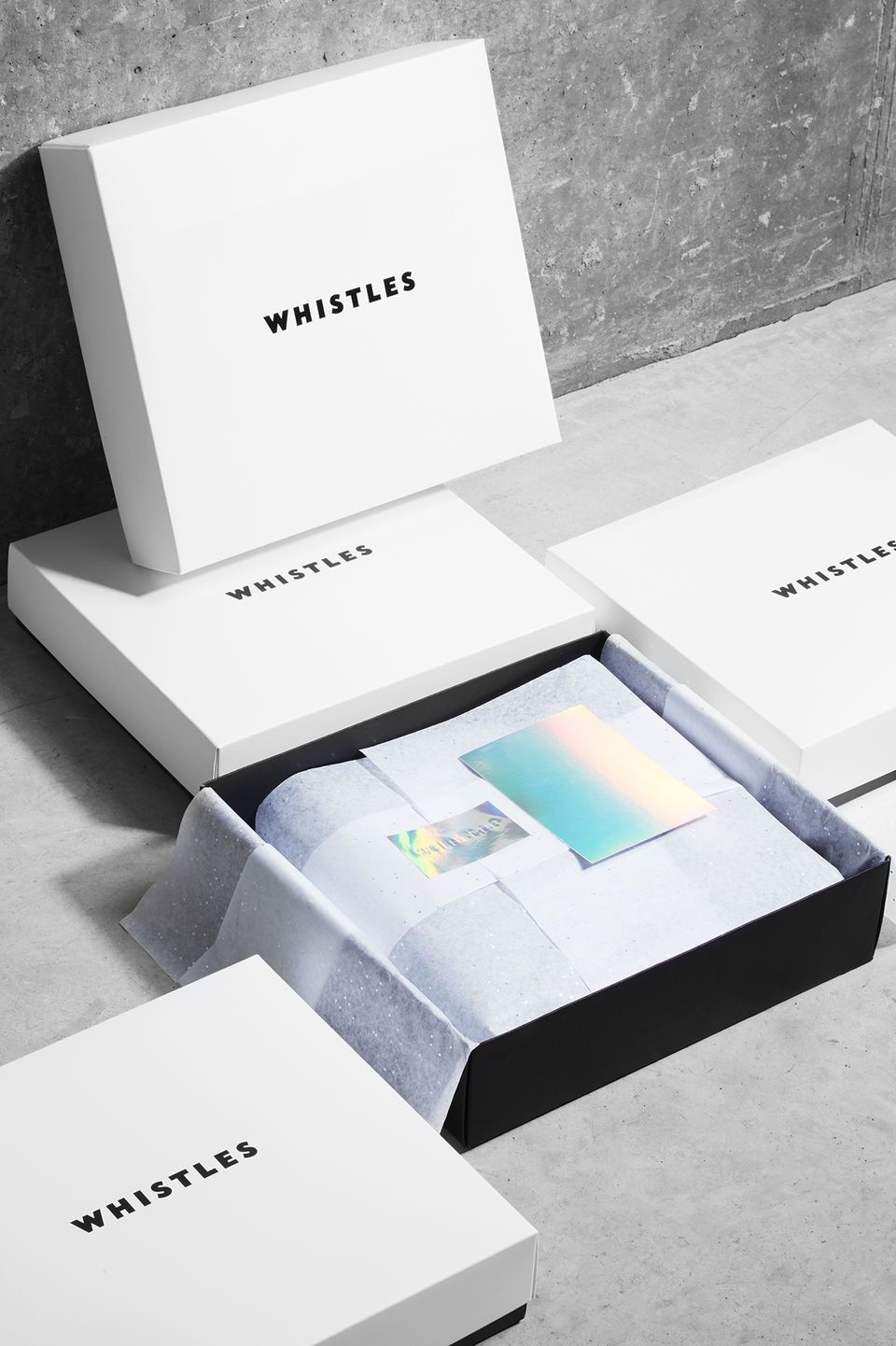 Sleek and elegant packaging. one simple sheet of tissue paper with a ...