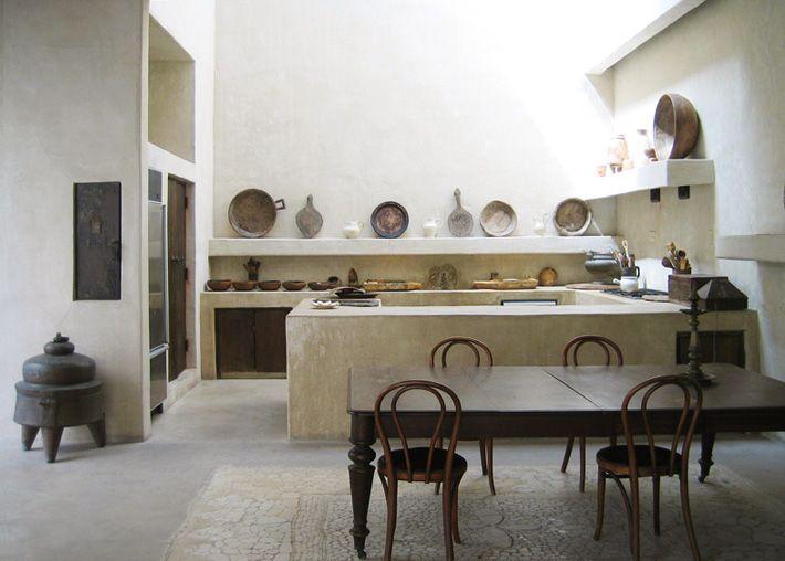 cocina abierta de obra, estilo rústico, suelo microcemento, sin