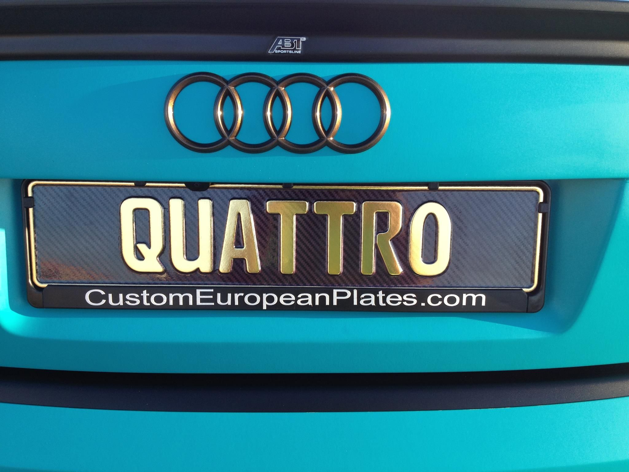 Custom Black License Plate With Gold Text Reading Quot Quattro