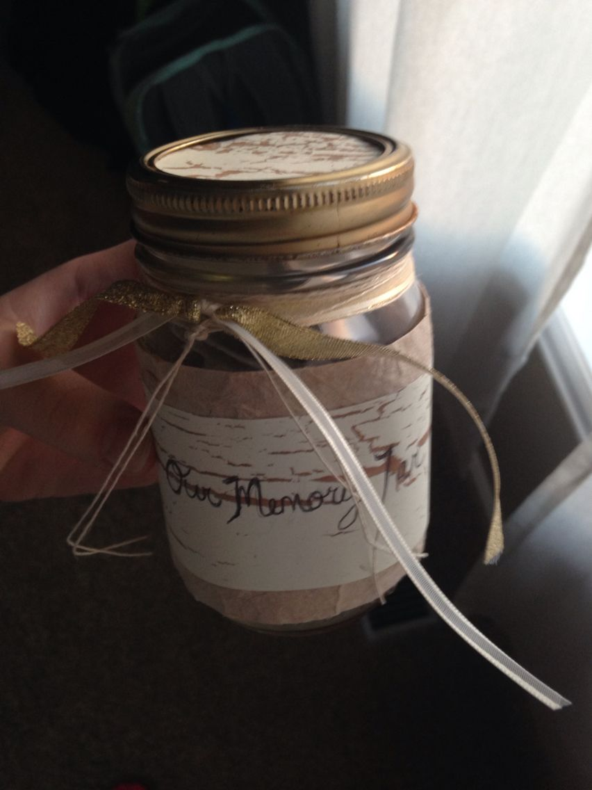 Boyfriend gift idea memory jar filled with folded up slips of